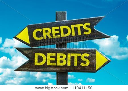 Credits - Debits signpost with sky background