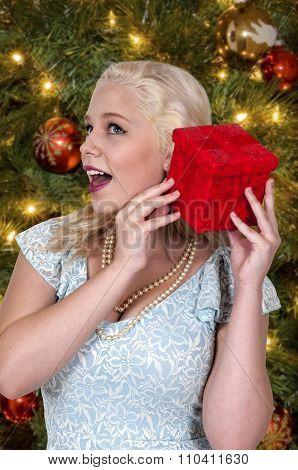 Beautiful Woman Shaking Gift