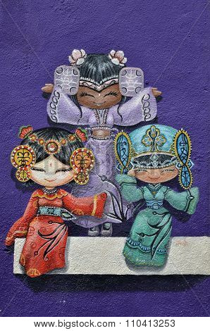 Colorful Street Art Painting Of Three Chinese Dolls In George Town, Penang, Malaysia.
