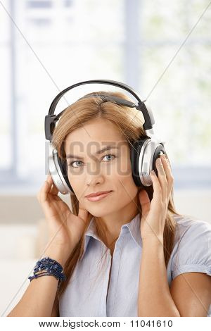 Attractive Girl Listening Music Through Headphones