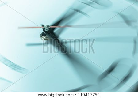 Clock with speeding time isolated on white background