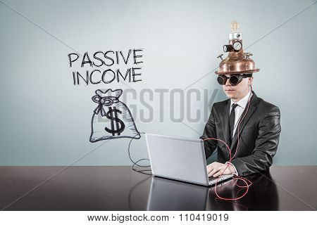 Passive income concept with vintage businessman and laptop