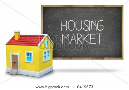Housing market on Blackboard with 3d house
