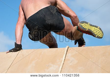 Man jumping over wal