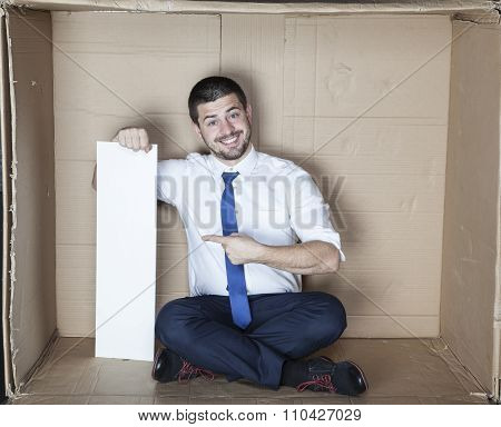 Happy Businessman Pointing To The Copy Space
