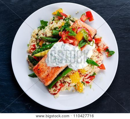 Pan Fried Salmon With Tender Asparagus, Courgette Served On Couscous Mixed With Sweet Tomato, Yellow