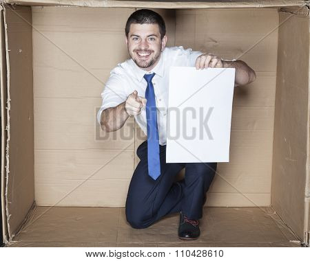 Business Man With Paper Pointing At You