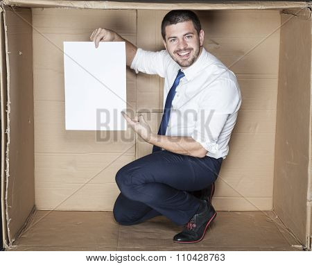 Businessman Pointing Sheet Of Paper
