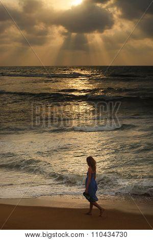Girl On A Beach On Sunset