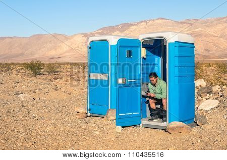 Man Sitting In The Toilet In The Middle Of The Desert - Death Valley California