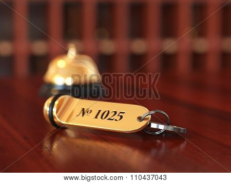 3D Rende Of Hotel Room Key With Golden Lable Room Number On The Wooden Table