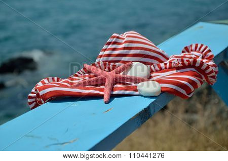 Red-white Bikini On Beach Bench