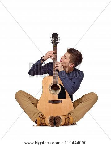 Guitarist Sitting With Acoustic Guitar