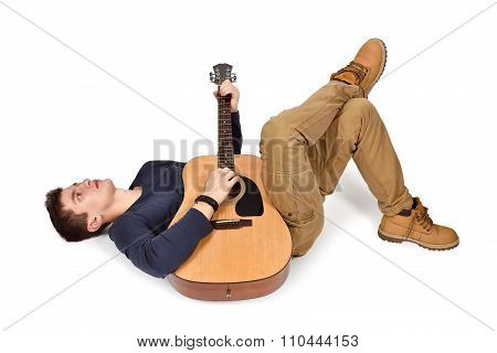 Guitarist Laying With Guitar.