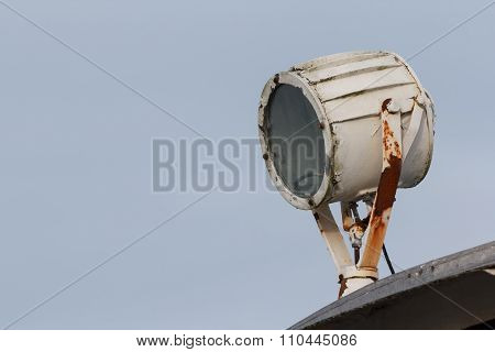 Marine signal light with rust on a boat