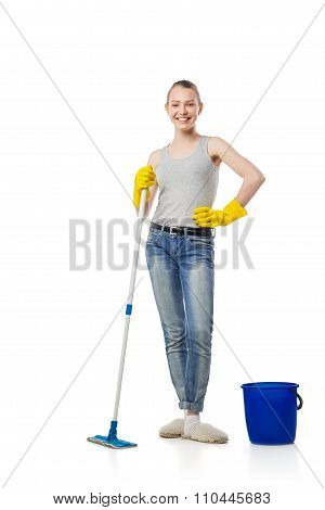 beautiful young woman standing with mop and bucket