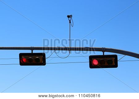 Red traffic light with surveillance camera