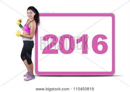 Fitness Woman With Numbers 2016 On The Board