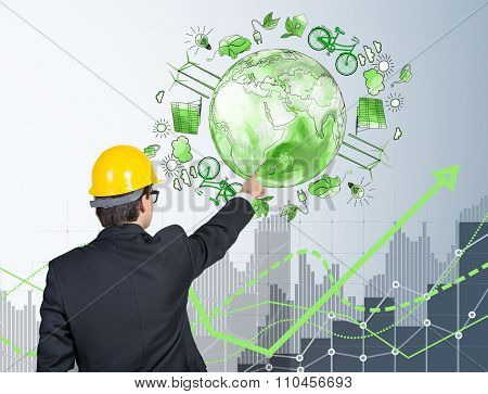 Man In Front Of Eco Energy Icons, Clean Environment