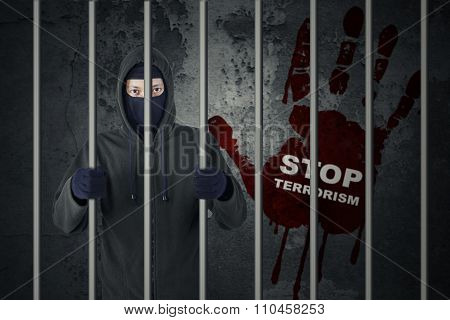 Stop Terrorism Concept With Terrorist In Jail