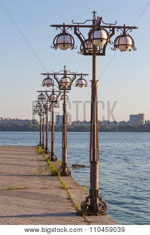 Metal Forged Lights On  Promenade Of  River.