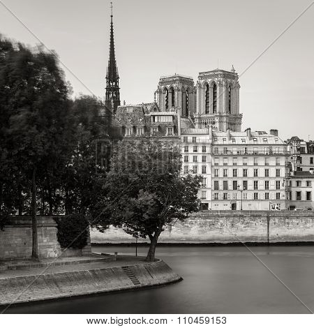 Notre Dame De Paris Cathedral Towers And Seine River Bank