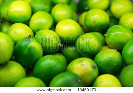 Lots Of Bright Green Limes In Supermarket.