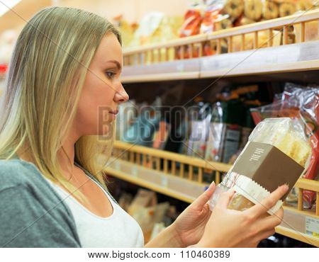Woman Choosing Pastries In Grocery Store.
