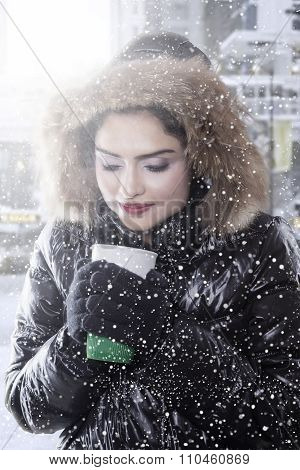 Woman Holds Hot Coffee And Wears Winter Coat