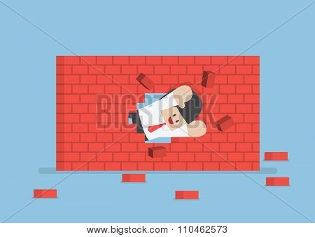 Businessman Breaking Through The Wall