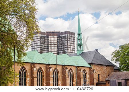 Cathedral in Essen and modern business tower, city skyline