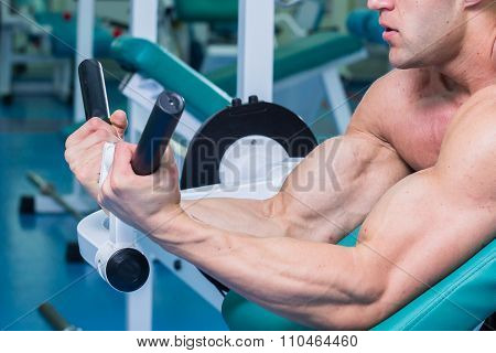 Tense muscles of hands under load