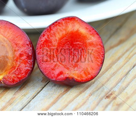 Close-up of ripe sliced plums