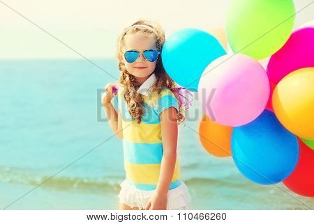 Portrait Happy Child On Summer Beach With Colorful Balloons Over Sea