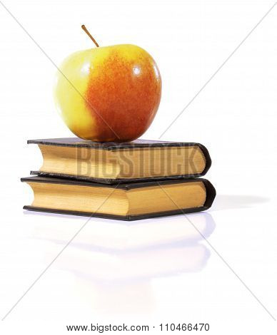 Apple on a book.