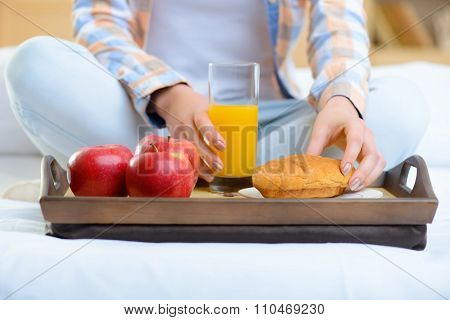 Healthy breakfast on wooden tray.