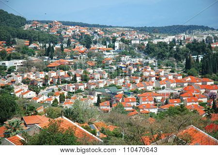 The Israeli city of Rosh Pina with red roofs and the Hula Valley
