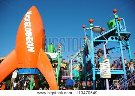 A water attraction with the Nickelodeon logo on an orange rocket