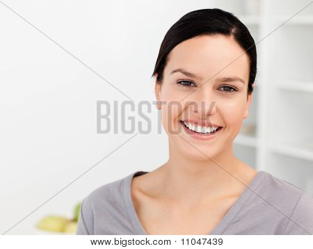 Cheerful Woman Standing In The Kitchen