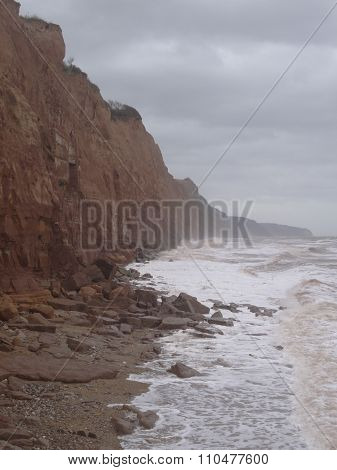 Waves Meeting A Rocky Cliffs Seascape