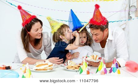 Happy Family Having Fn While Eating Birthday Cake