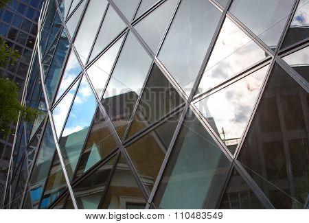 LONDON UK - SEPTEMBER 19, 2015 - Modern English architecture, Gherkin building glass texture. City o