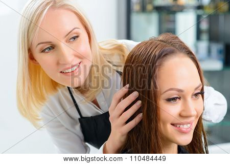 Stylist is busy with her customer.