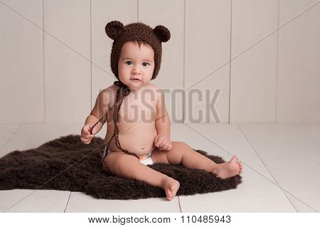 Baby Wearing A Bear Bonnet
