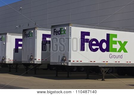 Indianapolis - Circa December 2015: Federal Express Trucks in Loading Docks.