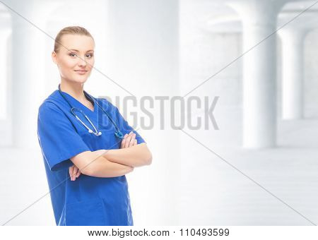 Beautiful and cheerful intern with stethoscope on background with university columns.