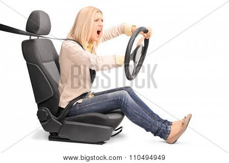 An outraged young woman pretending to drive and honking the horn isolated on white background