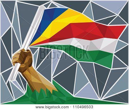 Creole Hand Raising The Flag Of Seychelles