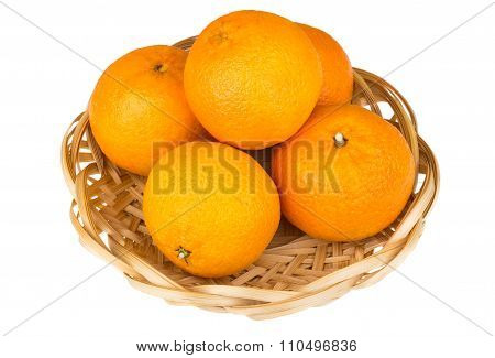 Heap Of Tangerine In Wicker Basket Isolated On White