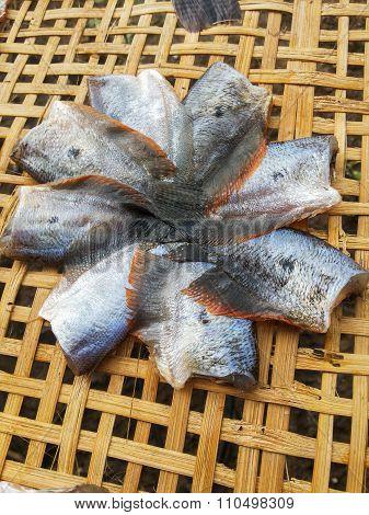 dry fish raw food on bamboo floor